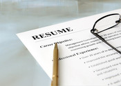 Main thumb depositphotos 11146010 stock photo resume on the table